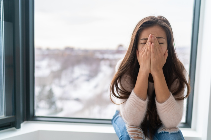 Anxiety winter depression woman having a panic attack and a hard