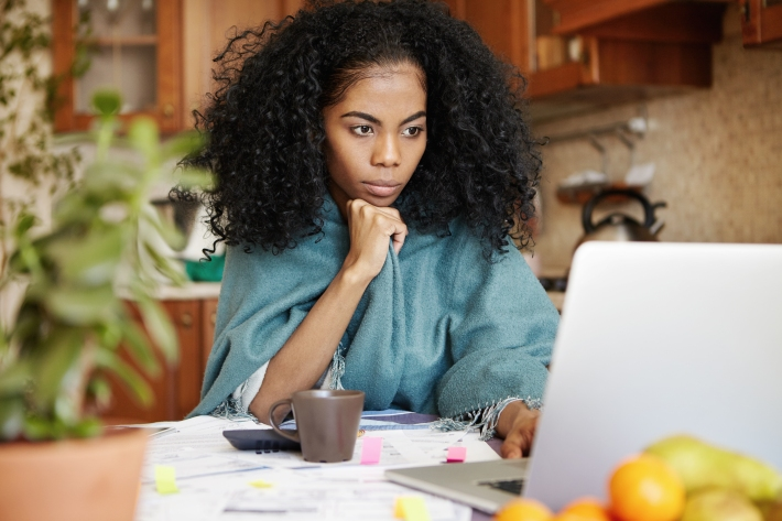 Beautiful African Woman Sitting In Front Of Laptop Computer, Loo