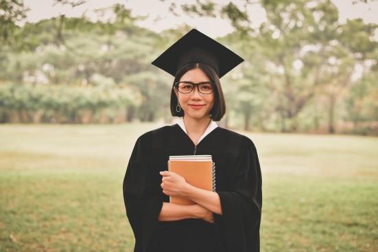 Graduation Concept. Graduated Students On Graduation Day. Asian