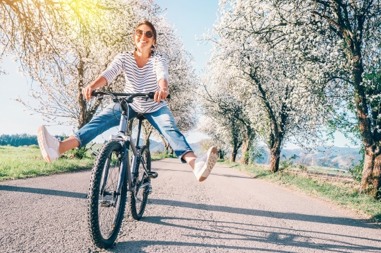 Happy Smiling Woman On Bicycle