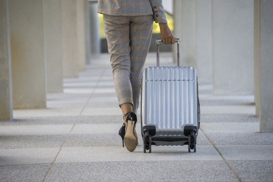 woman business traveler with suitcase