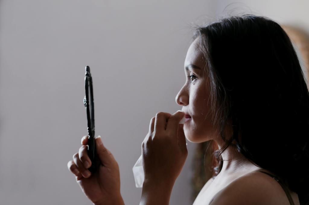 Women looking into a mirror